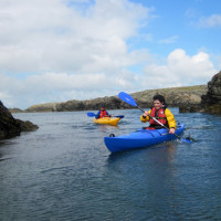 Photo of a woman sea kayaking