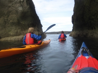 Sea Kayakers under the cliffs in Rhoscolyn