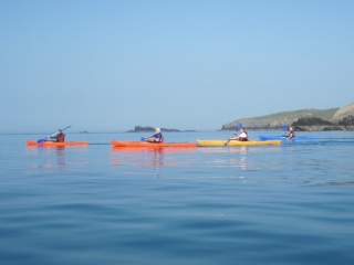 Sea kayakers Rhoscolyn Beacon