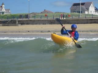 Kayakers in the surf Trearddur Bay