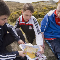 Young people using the mini-orienteering course