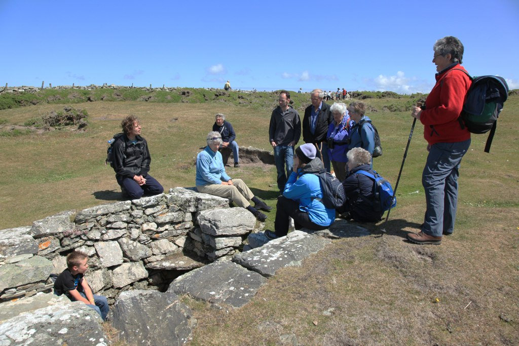 Photo of a group of walkers a St Gwenfaen's Well Rhoscolyn