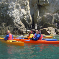 Photo of Group og young people learning to sea kayak