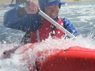 Surf Kayaking Trearddur Bay - grin and bear it